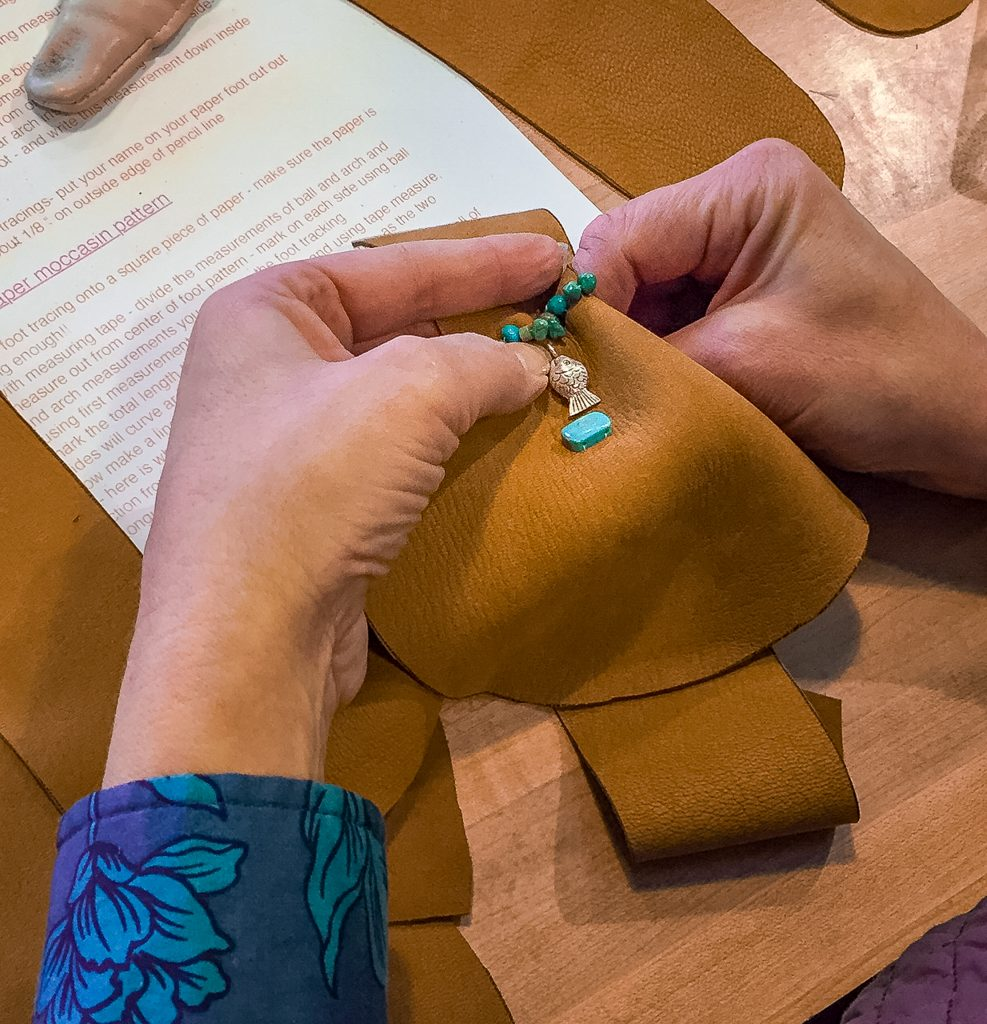Sewing moccasins